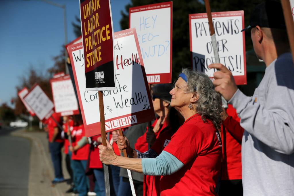 MRI tech Janice Cuneo takes part in a 24-hour long strike of union medical technicians and other support staff at Petaluma Valley Hospital in Petaluma on Wednesday, November 20, 2019. (BETH SCHLANKER/ The Press Democrat)