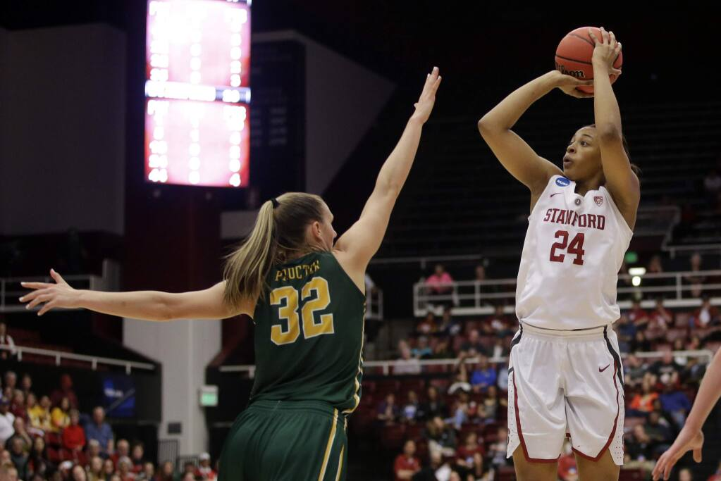 Stanford forward Erica McCall (24) shoots over San Francisco forward Taylor Proctor (32) in the first half of a game in the NCAA tournament Saturday, March 19, 2016, in Stanford. (AP Photo/Marcio Jose Sanchez)