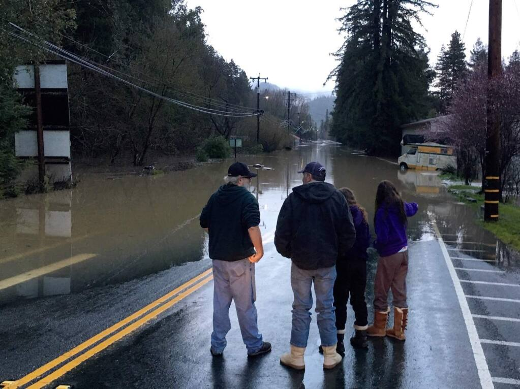 Flooding on River Road in Guerneville on Wednesday, Feb. 27, 2019. (KENT PORTER/ PD)