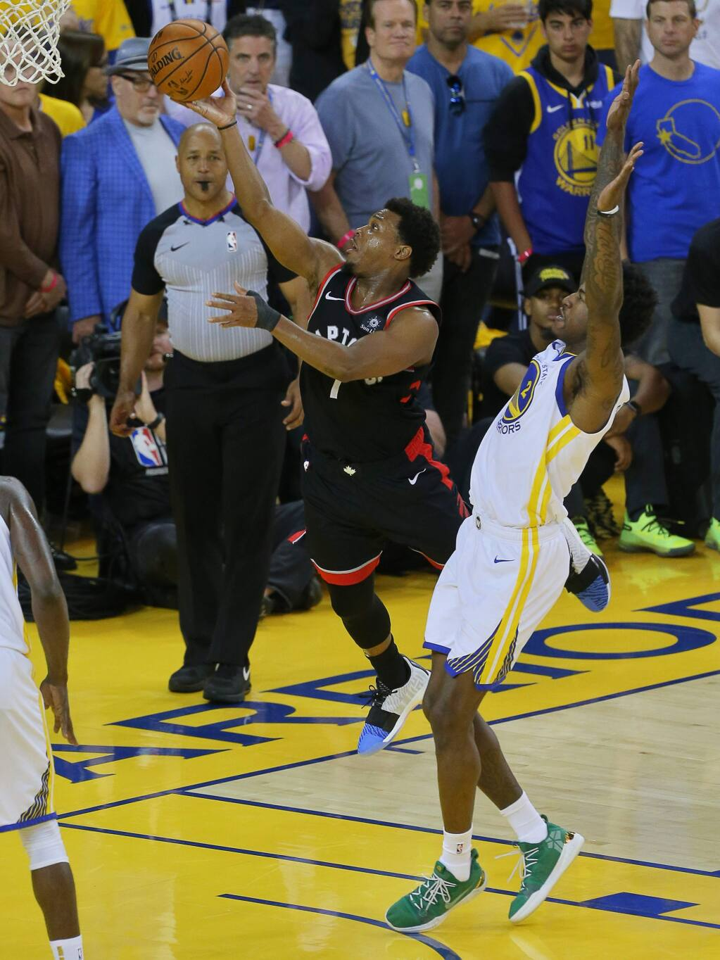 Toronto Raptors guard Kyle Lowry lays the ball in past Golden State Warriors forward Jordan Bell during game 3 of the NBA Finals in Oakland on Wednesday, June 5, 2019. (Christopher Chung/ The Press Democrat)