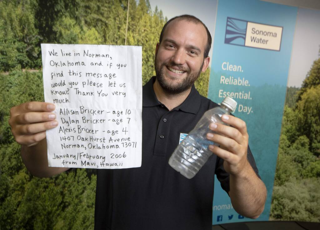 Eric McDermott, a biologist for the water agency, found a message in a bottle during an Earth Day clean-up in Jenner. The bottle had been floating since 2006 and the authors have since moved to Santa Rosa. (photo by John Burgess/The Press Democrat)