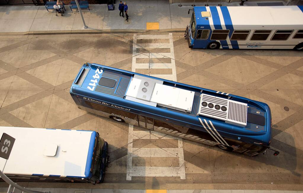 At the transit mall in Santa Rosa, city buses come and go, Friday July 31, 2015. (Kent Porter / Press Democrat)