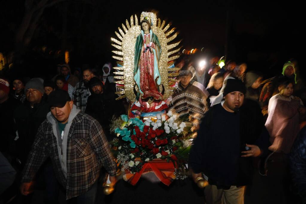 Members of Our Lady of Guadalupe Catholic Church carry a figure of Mary as the procession for Feast Day of Our Lady of Guadalupe makes its way along Old Redwood Highway in Windsor on Wednesday, Dec. 12, 2018. (BETH SCHLANKER/ PD)