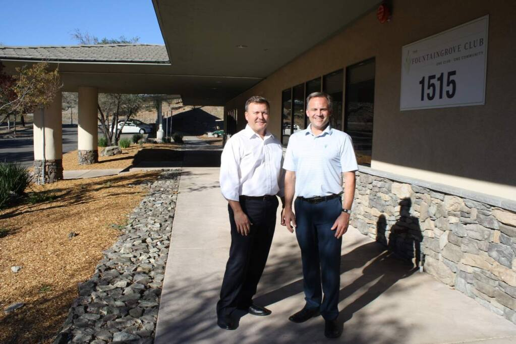 Mark Leavitt (left), past president of the Fountaingrove Golf and Country Club, past president and board liaison to the steering committee and architect on the building design, and Chief Operating Officer Ron Banaszak in front of the Athletic Center that survived the fire to also become a Comfort Center for fire victims. (Gary Quackenbush / for North Bay Business Journal) October 2018