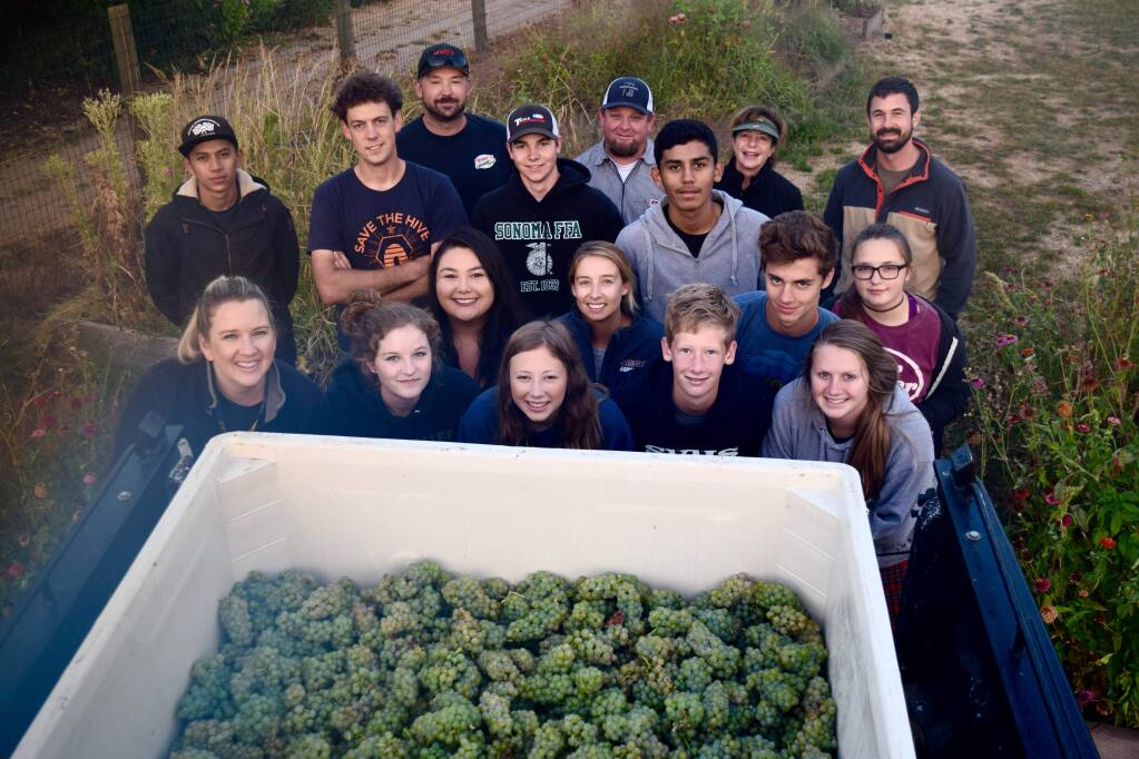 SVHS agriculture teacher Dan Aschwanden, back row fourth from right in baseball cap, pictured with students and SVHS staff.  File photo,