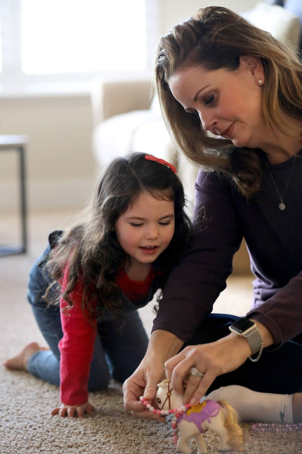 Keri Vellis plays with her adopted daughter Sara, 4, at their home in Santa Rosa on Sunday, Jan. 12, 2020. (BETH SCHLANKER/ The Press Democrat)