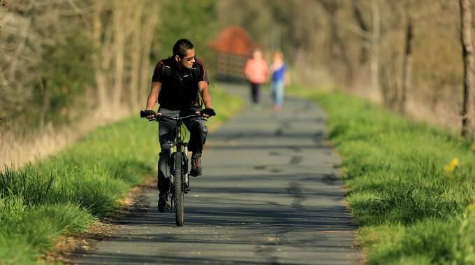 A leisurely ride on your favorite road or trail (Santa Rosa Creek Trail, here) without a helmet could cost you money; proposed legislation would require that anyone riding a bike without sans head gear would face a fine, Friday Feb. 13, 2014. (Kent Porter / Press Democrat) 2015