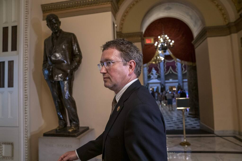Republican, Rep. Thomas Massie, R-Ky., leaves after speaking to reporters at the Capitol where he blocked a unanimous consent vote on a long-awaited $19 billion disaster aid bill in the chamber on Tuesday, May 28, 2019. (AP Photo/J. Scott Applewhite)