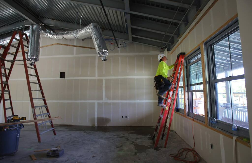 Jorge Rodriguez works on a room at the Santa Rosa Charter School for the Arts, in Santa Rosa, on Wednesday, August 24, 2016. (Christopher Chung/ The Press Democrat)