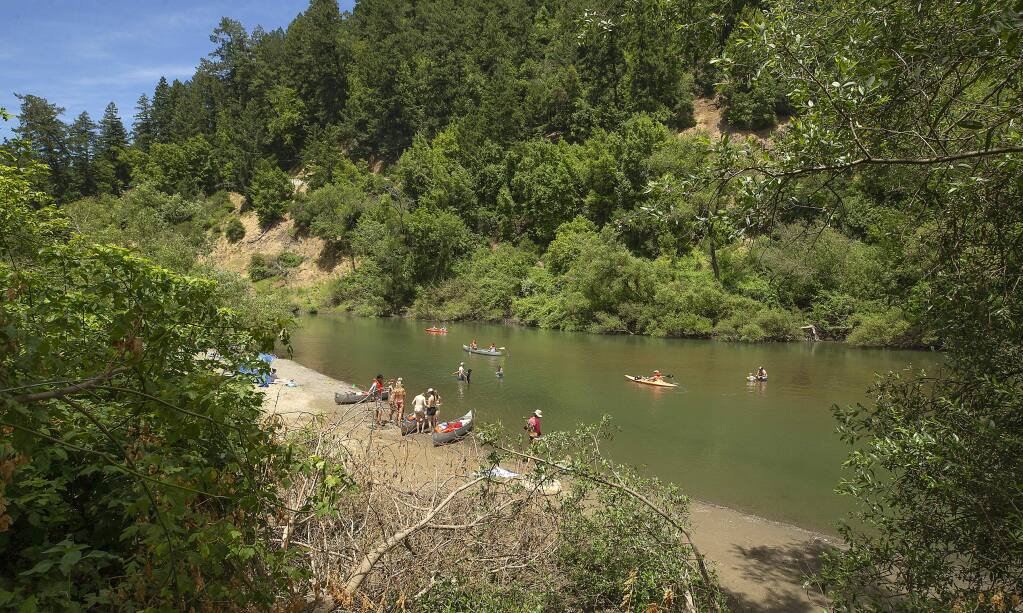 photos by John Burgess / The Press Democrat Mother's Beach is suddenly a lot smaller because of powerful river flows that have reshaped the Russian River near Hacienda Bridge in Forestville.