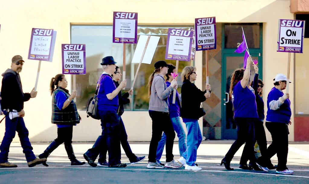 Service Employees International Union Local 1021 protest in downtown Santa Rosa, Thursday Nov. 19, 2015, the final day of their three-day strike. (Kent Porter / Press Democrat)