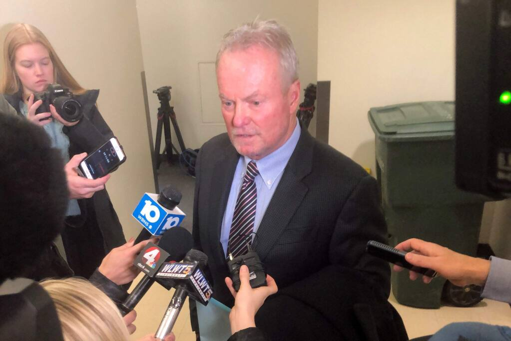Defense attorney Karl Schneider, representing former Ohio State football player Amir Riep, speaks to reporters after entering a not guilty plea on behalf of his client Thursday, February 13, 2020, in Columbus, Ohio. Riep, who was dismissed from the team on Feb. 12, 2020 ,along with teammate and co-defendant Jahsen Wint, are charged with the rape and kidnapping of a 19-year-old woman on Feb. 4, 2020 at an apartment the two men share. (AP Photo/Andrew Welsh-Huggins)