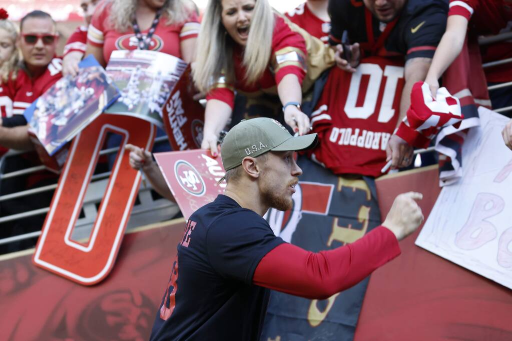 San Francisco 49ers tight end George Kittle greets fans before a game against the Arizona Cardinals in Santa Clara, Sunday, Nov. 17, 2019. (AP Photo/Josie Lepe)