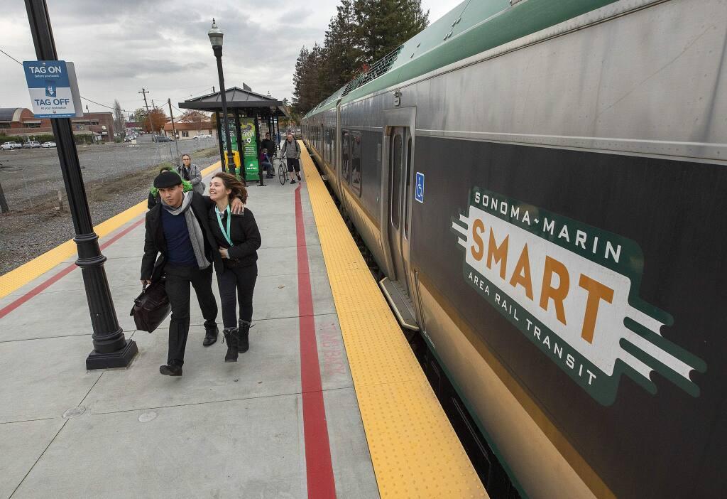 SMART riders exit the train at the Railroad Square station in Santa Rosa. (JOHN BURGESS / The Press Democrat)