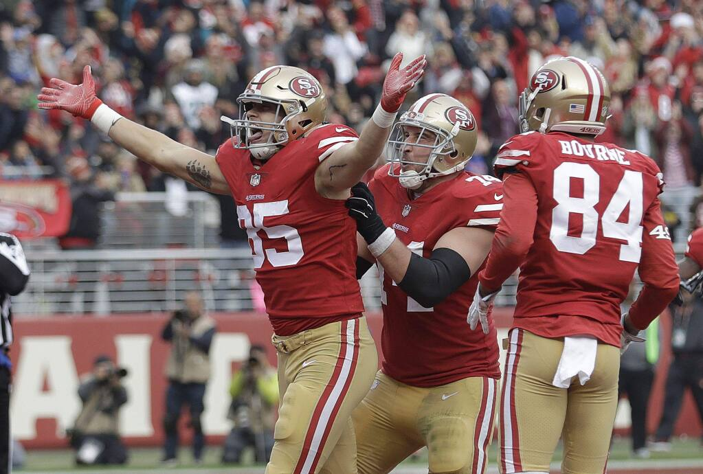 San Francisco 49ers tight end George Kittle (85) celebrates after scoring a touchdown against the Jacksonville Jaguars during the second half in Santa Clara, Sunday, Dec. 24, 2017. (AP Photo/Marcio Jose Sanchez)
