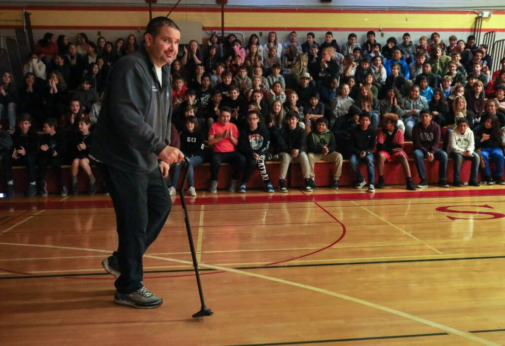 Bryan Stow shows students at Herbert Slater Middle School his progress in walking with a cane during his anti-bullying awareness presentation in Santa Rosa on Friday, December 6, 2019. Stow was attacked following a baseball game at Dodger Stadium in 2011.(Christopher Chung/ The Press Democrat)