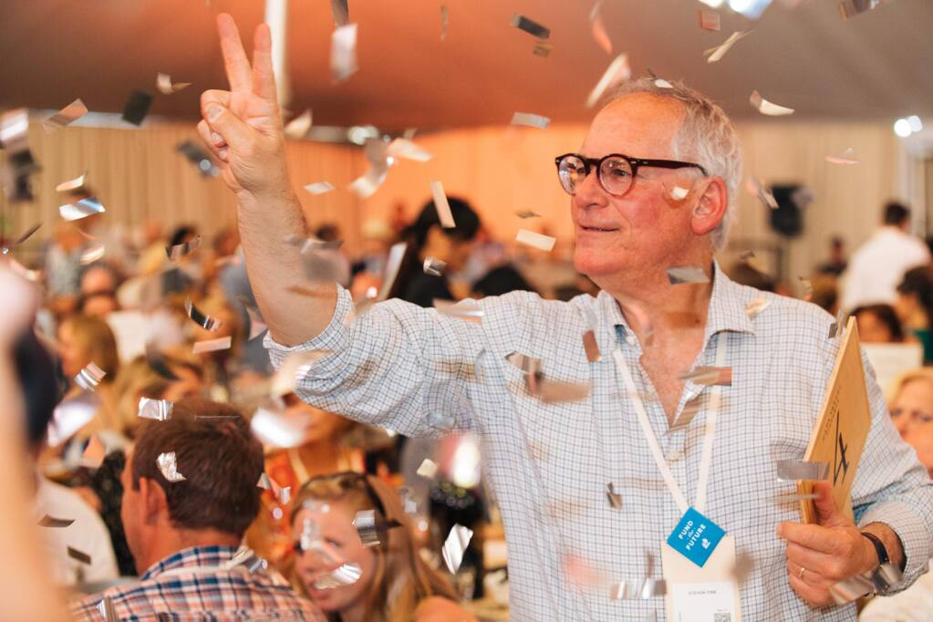 A winning bidder at the Auction Napa Valley 2018 live auction, held at Meadowood Napa Valley on June 2, 2018. (Alexander Rubin / for Napa Valley Vintners)