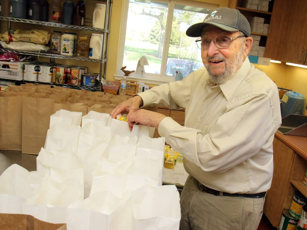 Volunteer Sid Lipton packs meals for Meals on Wheels food program for seniors at the senior center at Lucchesi Park in Petaluma on Tuesday March 31, 2015. (SCOTT MANCHESTER/ARGUS-COURIER STAFF)