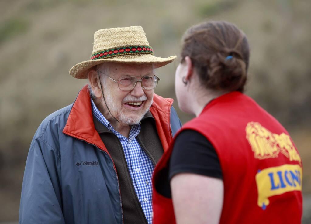 Coastal conservationist Bill Kortum talks with Lions Club member Sabrina Roncancio at Blind Beach on Saturday, September 20, 2014 near Jenner, California. (BETH SCHLANKER/ The Press Democrat)