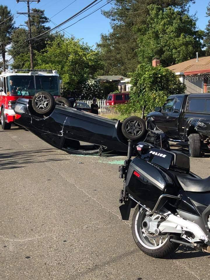 A Santa Rosa driver swerved into a parked pickup on Corby Avenue and flipped his Acura sedan Tuesday, Sept. 10, after dropping his cell phone. (Santa Rosa Police Department/Facebook)