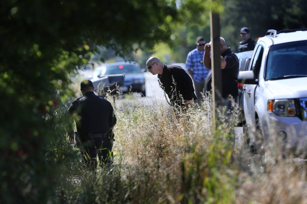 Petaluma police officers investigate the scene of a fatal motorcycle accident near 3765 Lakeville Hwy in Petaluma, California on Tuesday, May 28, 2019. (BETH SCHLANKER/The Press Democrat)