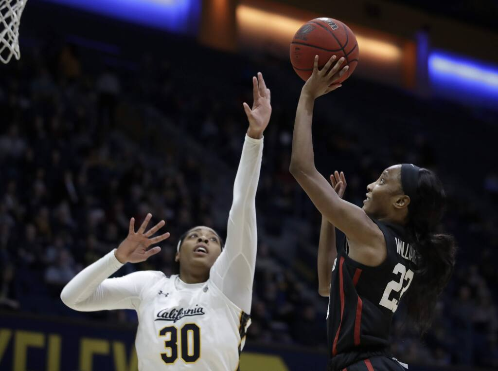 Stanford's Kiana Williams, right, shoots against Cal's CJ West in the first half Sunday, Jan. 12, 2020, in Berkeley. (AP Photo/Ben Margot)