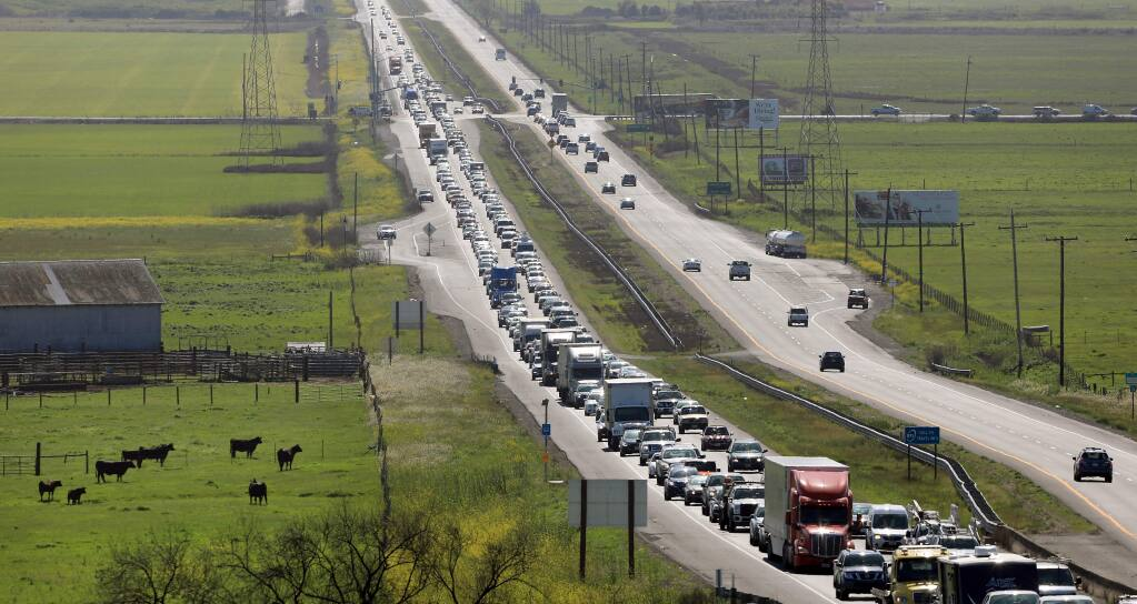 Traffic backs up along eastbound Highway 37 near Lakeville Highway on Monday, April 2, 2018. (Kent Porter/ The Press Democrat)