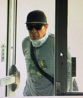 Petaluma police arrested Juan Jose Flores Jr., a 44-year-old Lakeport resident, early Friday morning on suspicion of robbing a Bank of America Wednesday. Police say this surveillance photo shows Flores Jr. entering the bank. (Petaluma Police Department)