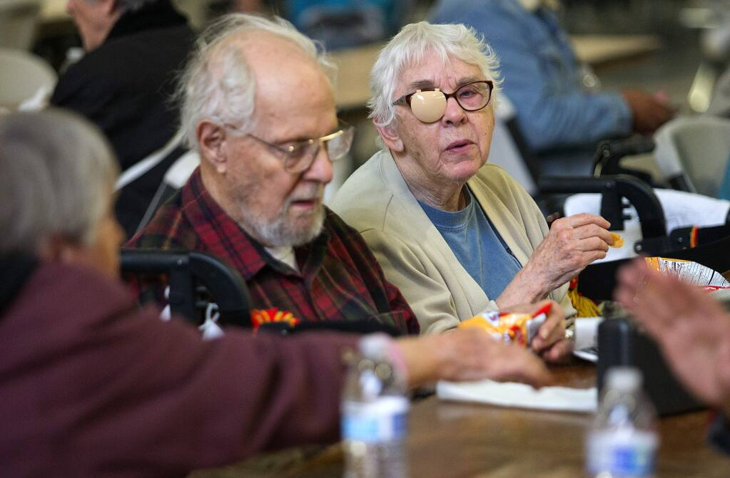 Jerry and Norma Sonosky evacuated their home in Spring Lake Village and joined over 400 other evacuees in the Red Cross shelter at the Sonoma County Fairgrounds on Tuesday. (photo by John Burgess with Helico/The Press Democrat)