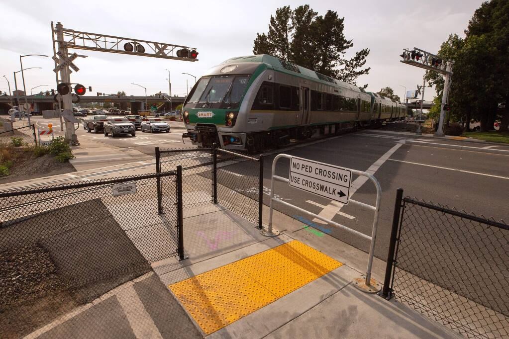A southbound SMART train passes in front of a newly installed Z gate for pedestrians where Golf Course Drive intersects with the railway in Rohnert Park, California, on Tuesday, July 9, 2019. Two people were killed by SMART trains at this railway intersection in two separate accidents, a day apart. (Alvin Jornada / The Press Democrat)