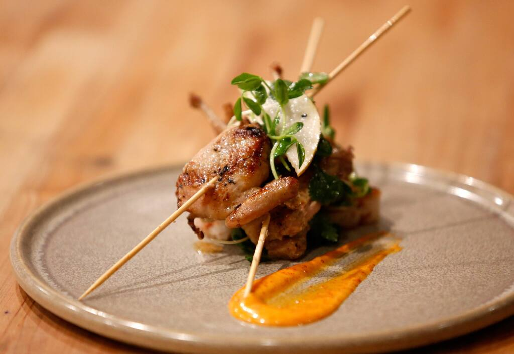Wood grilled quail 'kalbi style' with bacon-lap chung fried rice and crisp pear salad at Bird and The Bottle, in Santa Rosa. Bird and The Bottle was named 'Best New Restaurant' in the Best of Sonoma County 2016. (Alvin Jornada / The Press Democrat)