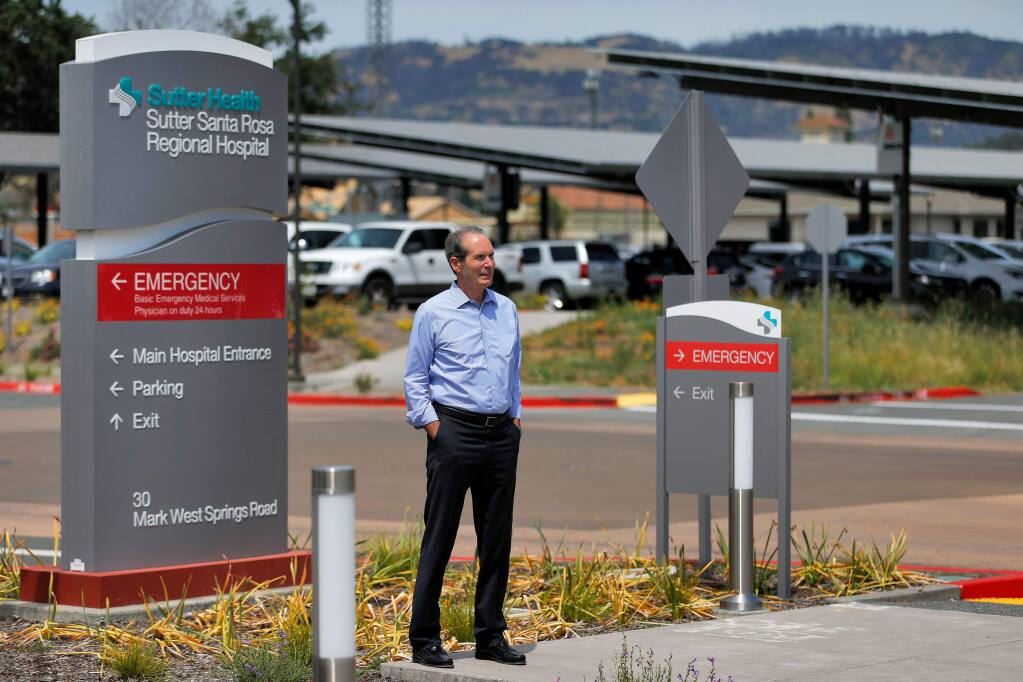 Sutter Santa Rosa Regional Hospital CEO Mike Purvis stands in front of some of the solar panel arrays placed in Sutter hospital's parking lots in Santa Rosa, California, on Thursday, June 13, 2019. (Alvin Jornada / The Press Democrat)