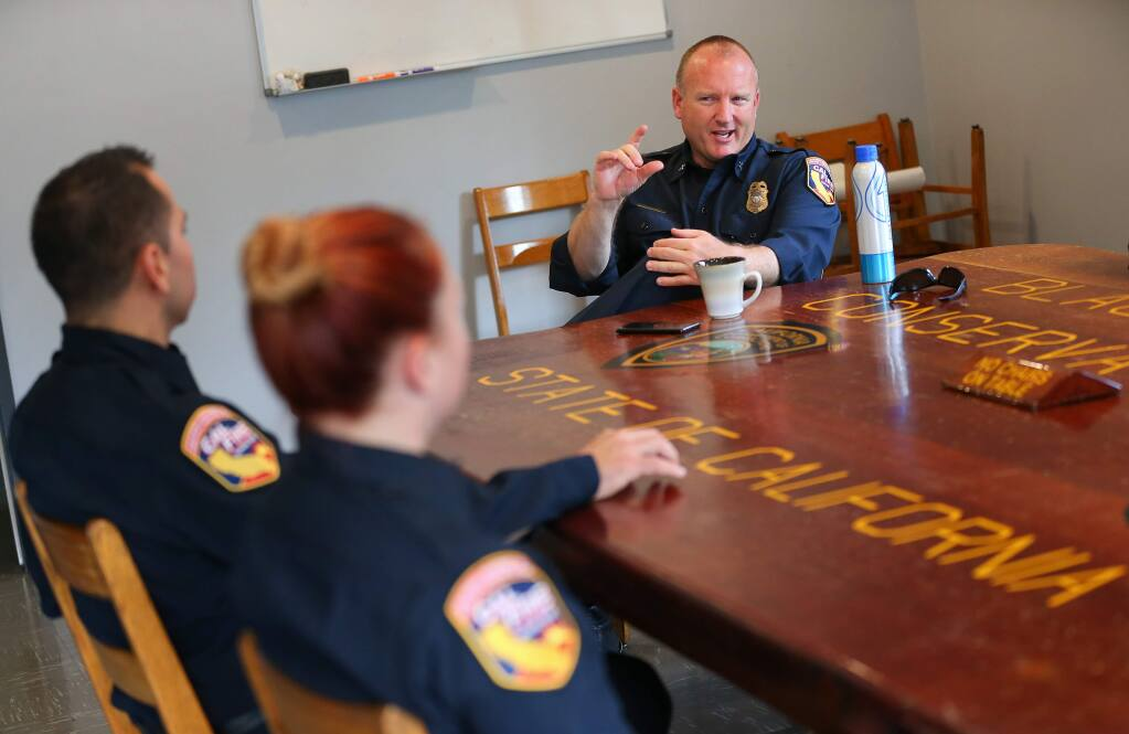 CAL FIRE Battalion Chief Marshall Turbeville, right, meets with fire personnel at the CAL FIRE Hilton Station in Guerneville on Friday, November 15, 2019. (Christopher Chung/ The Press Democrat)