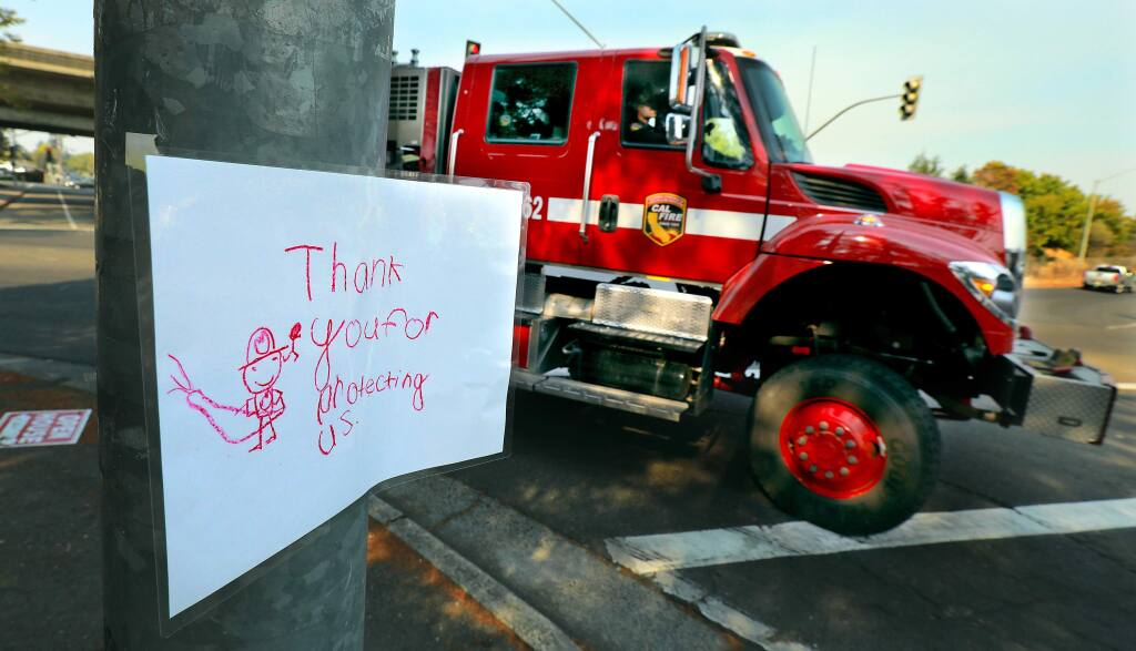 A sign created by a child greet fire trucks as they return for a rest at the Sonoma County Fairgrounds on October 12, 2017. (photo by John Burgess/The Press Democrat)