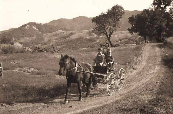 John McCormick drives his daughters, Babe and Ina down the mountain, probably in the late 1920s. (Jim Perry via Sonoma Land Trust)