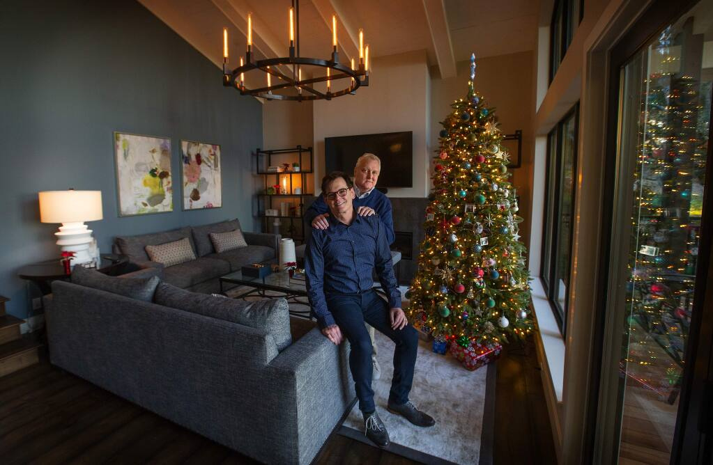 Peter Lasalle and Mark Ritter bought their home in Montecito Heights just four days after they lost their home in the Tubbs Fire in October, 2017. A year later they have completed their remodel complete with a Christmas tree. (photo by John Burgess/The Press Democrat)