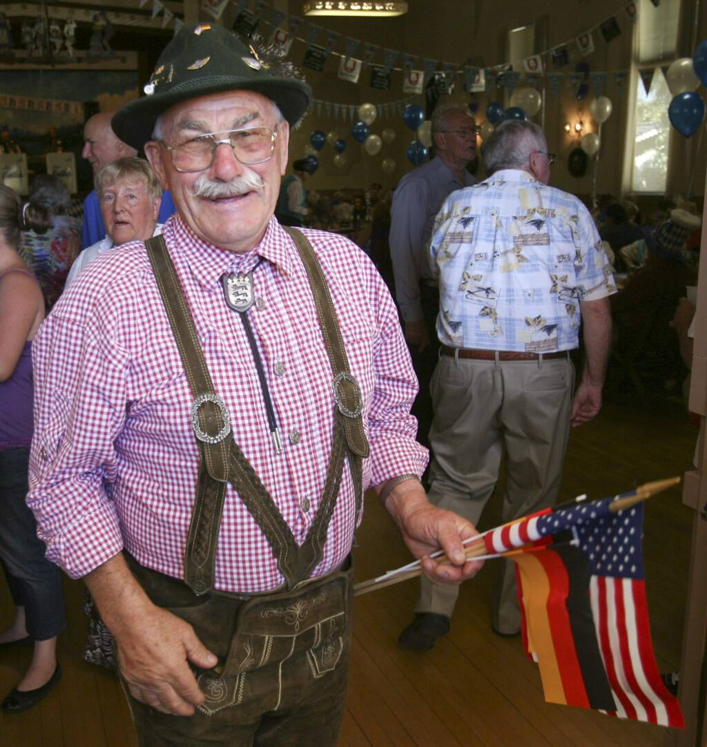 Manfred Gruener organizing the Entry of the flags at the front door at the Oktoberfest at Hermann Sons Hall on Sunday October 12, 2014. (SCOTT MANCHESTER/ARGUS-COURIER STAFF)