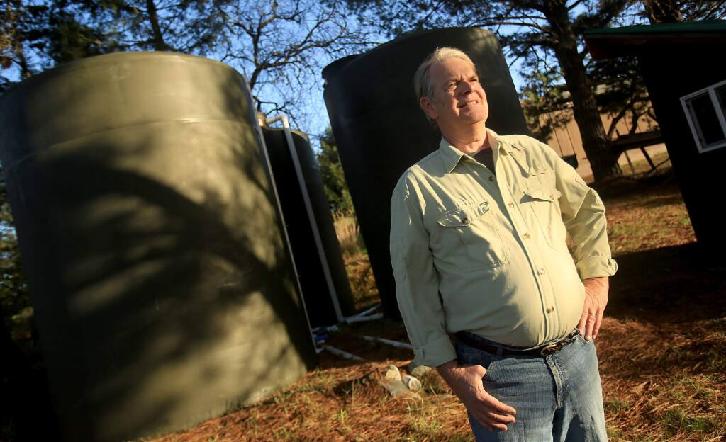 Karl Anderson at his Bodega home where he built a rainwater catchment system, complete with 15,000 gallon water tanks, Wednesday Dec. 23, 2015. (Kent Porter / Press Democrat ) 2015
