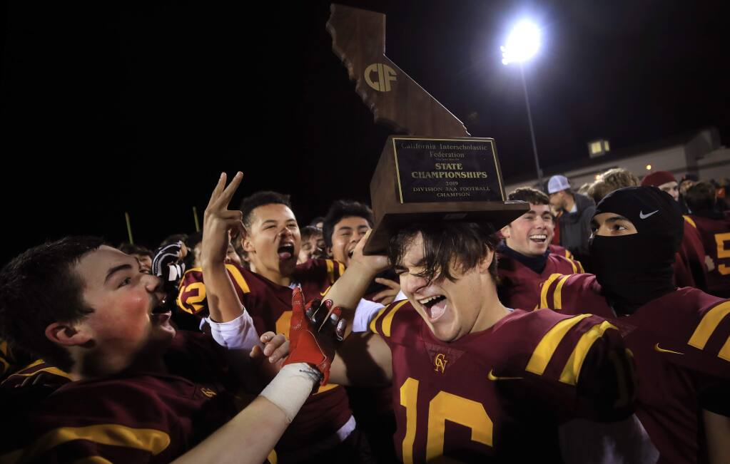 Ethan Kollenborn and the rest of his Cardinal Newman teammates celebrate their Division 3-AA state championship victory over the El Camino High School Wildcats of Oceanside, Saturday, Dec.14, 2019 in Santa Rosa. (Kent Porter / The Press Democrat)