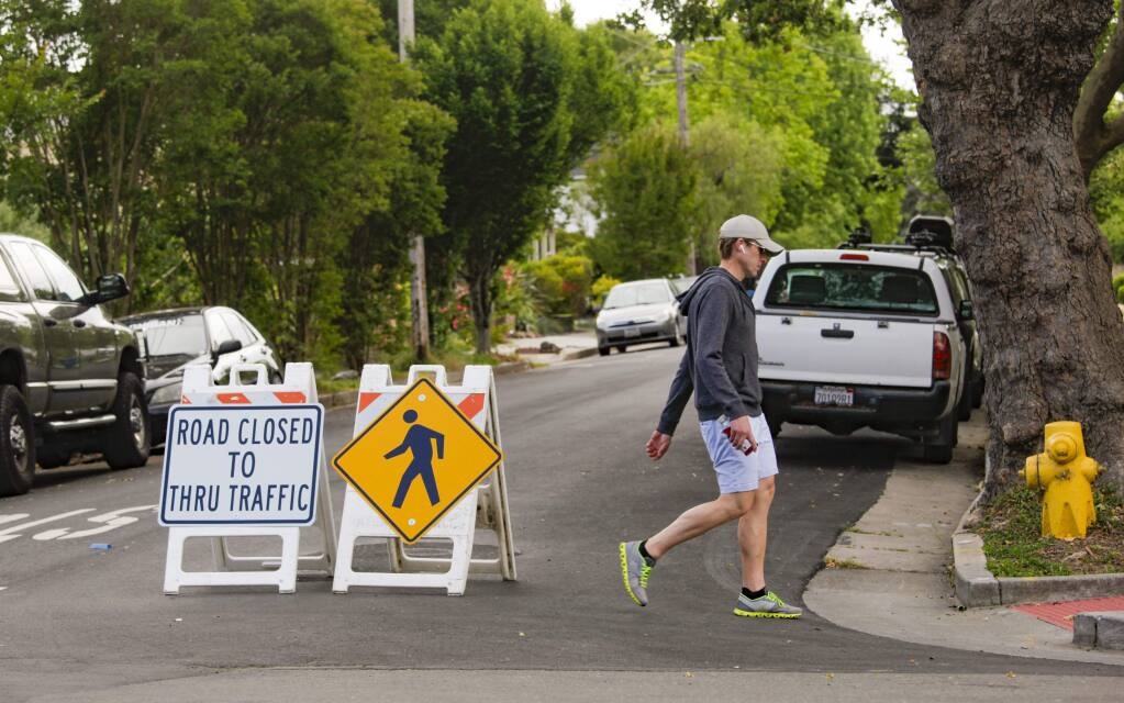 "In May 2020, Petaluma started a pilot program to create ""slow streets,"" where pedestrians and cyclists can use the entire road for social distancing while driving is curtailed. (CRISSY PASCUAL/ARGUS-COURIER STAFF)"