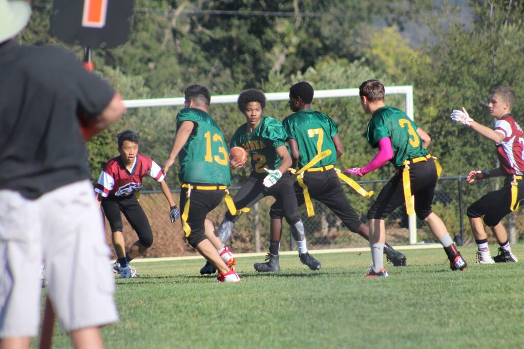 Watch the flag-guarding! Many Hanna boys participate in such sports as flag football.