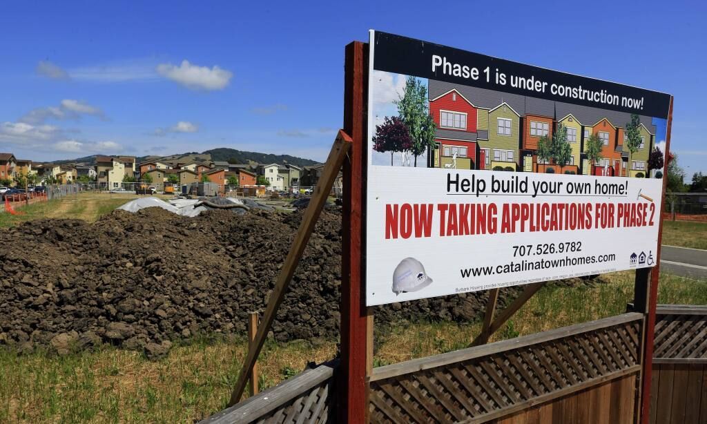 A sign for Catalina Townhomes on Dutton Meadow in Santa Rosa.(JOHN BURGESS/ PD)