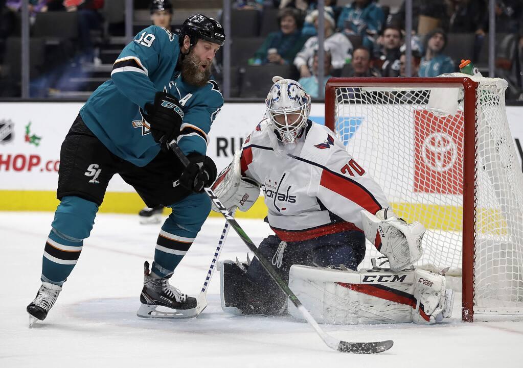 San Jose Sharks' Joe Thornton, left, takes a shot against Washington Capitals goalie Braden Holtby (70) during the third period of an NHL hockey game Tuesday, Dec. 3, 2019, in San Jose, Calif. (AP Photo/Ben Margot)