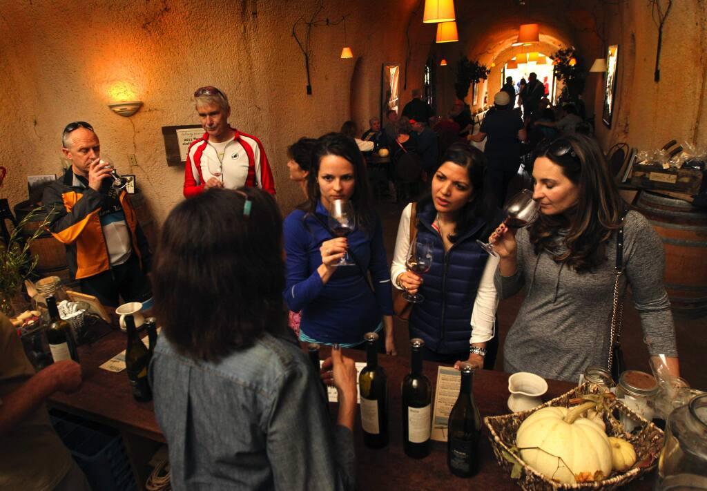 Jenny Draxl of Chicago, left, Radhika Nayar of New York and Jenna Love of Detroit taste wine at the bar at Bella Vineyards on WestDryCreek Road west of Healdsburg on Saturday, Oct. 25, 2014. (JOHN BURGESS/ PD)
