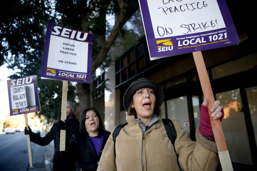 Kelly Brockway strikes with members of Service Employees Union Local 1021 in Santa Rosa, on Tuesday, Nov. 17, 2015. (BETH SCHLANKER/ PD)
