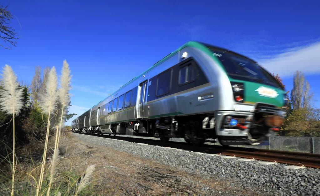 A SMART train passes through Rohnert Park at Southwest Blvd. on Friday. (John Burgess/The Press Democrat)