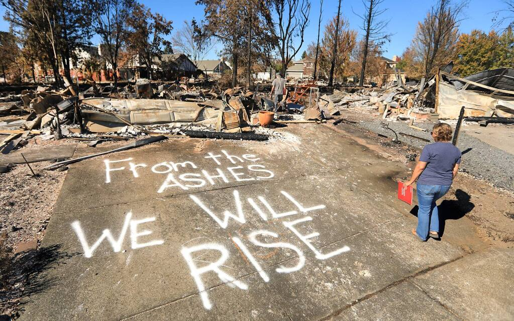 At Coffey Park in Santa Rosa, Traci Lattie and her partner Wayne Hovey vowed to rebuild. They met Oct. 23 with their insurance agent. (Kent Porter / Press Democrat) 2017