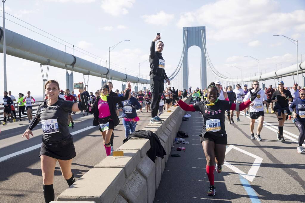 Runners make their way across the Verrazzano-Narrows Bridge during the start of the New York City Marathon, Sunday, Nov. 3, 2019, in New York. (AP Photo/Julius Motal)