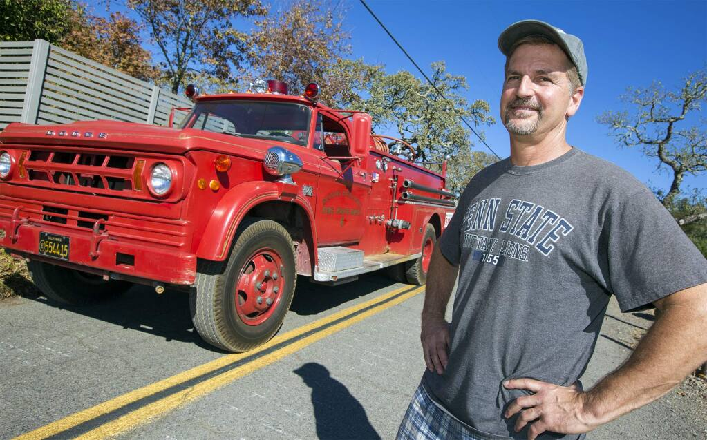 Tim Gray with his Mission Highlands fire truck. (Photo by Robbi Pengelly/Index-Tribune)
