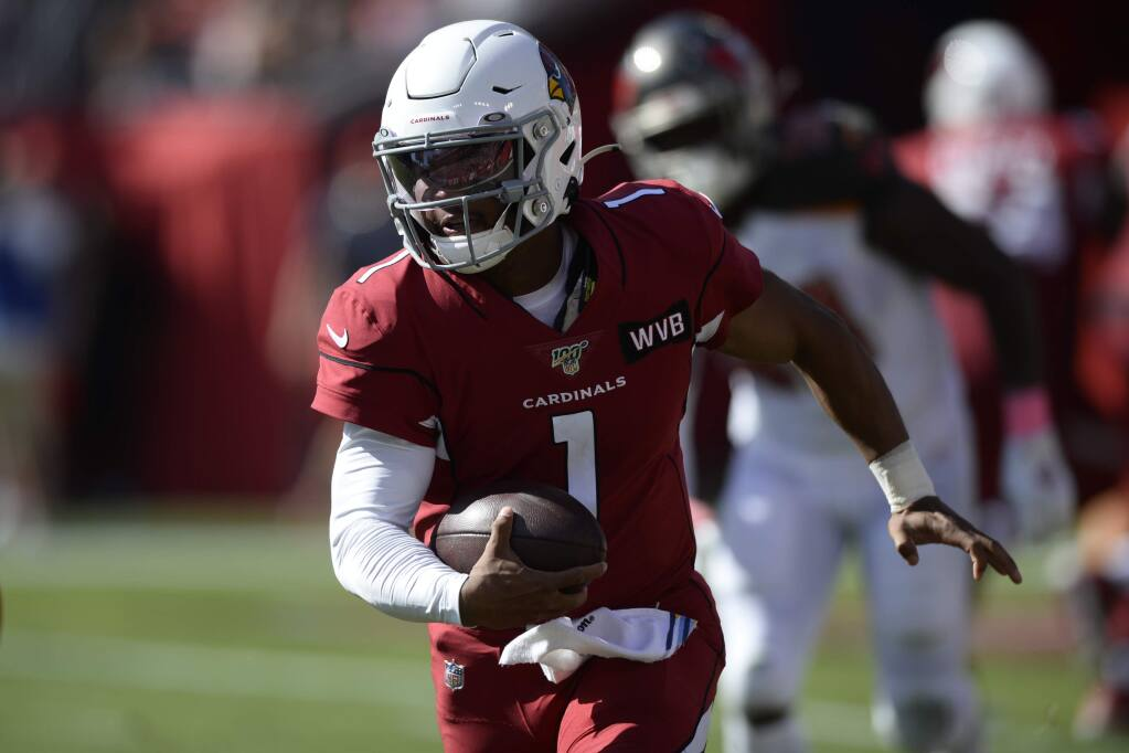 Arizona Cardinals quarterback Kyler Murray runs against the Tampa Bay Buccaneers during the first half Sunday, Nov. 10, 2019, in Tampa, Fla. (AP Photo/Jason Behnken)